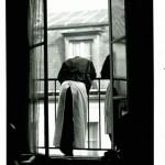 A WAITER AT A WINDOW